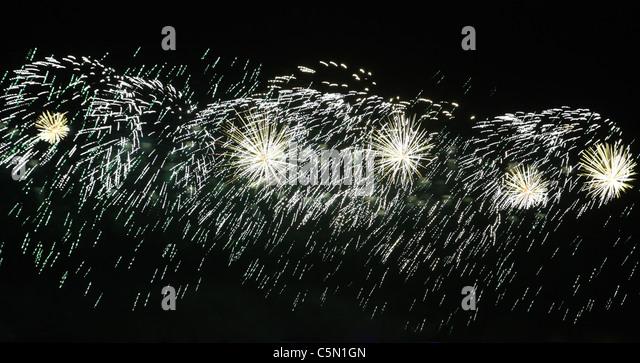 Fireworks, festive lights against the black night sky - Stock Image