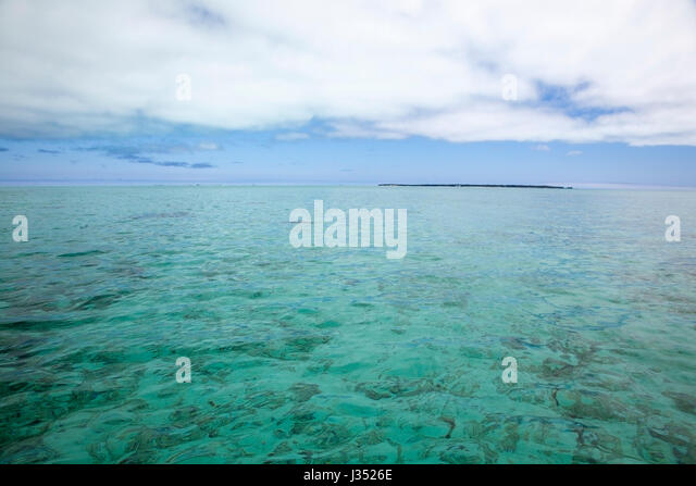 Sand Island in Midway Atoll lagoon, Papahanaumokuakea Marine National Monument - Stock Image