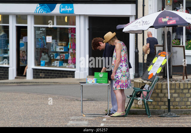 Charity stall on a Suffolk street market - Stock Image