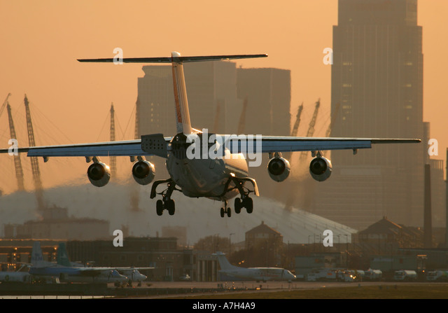 Air France CityJet British Aerospace BAe 146 200 landing at London City Airport with Millenium Dome in the background - Stock Image