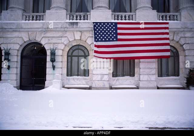 American Flag in winter with snow, Washington D.C. - Stock Image