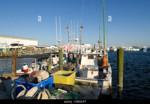 Commerical Fishing Boats at dock Mill Creek Marina, Wanchese, North Carolina on Outer Banks - Stock Image