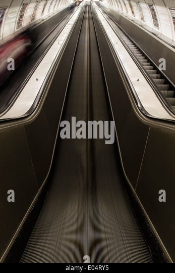 Underground escalator in motion - Stock Image