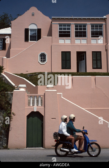 Bermuda St. George homes couple rental scooter nation - Stock Image