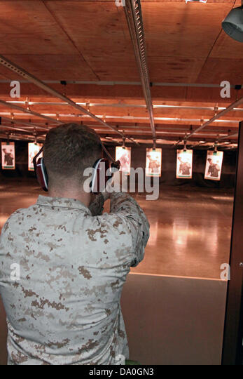 A US Marine fires at a zombie target during the US Marine Corps Zombie Shoot Out June 28, 2013 in Iwakuni, Yamaguchi, - Stock Image