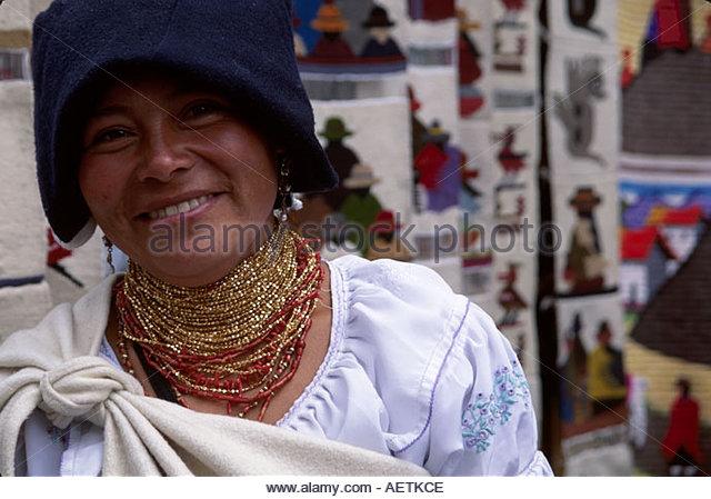 Ecuador Otavalo Market female blanket vendor Indigenous natives - Stock Image