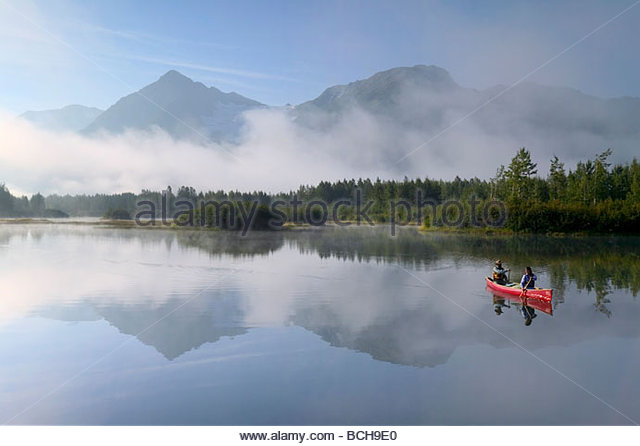 Couple Canoeing on Lake Portage Valley SC AK Summer - Stock Image
