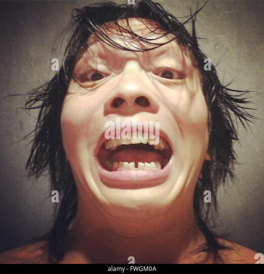 Close-Up Portrait Of Man Making Face - Stock-Bilder