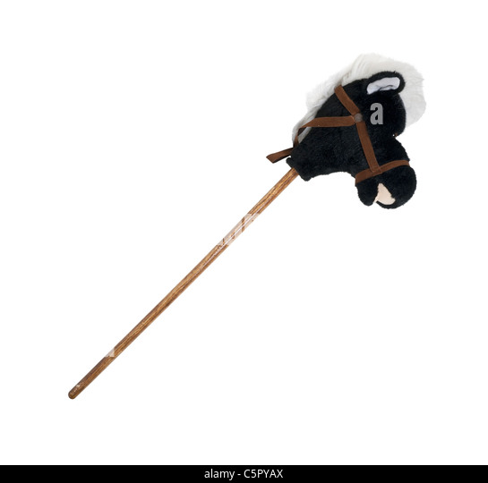 Plush hobby horse with a wooden stick for a body to represent childhood - path included - Stock Image