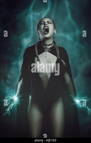 Thunder witch calling magical powers . Fantasy and surreal studio shot - Stock-Bilder