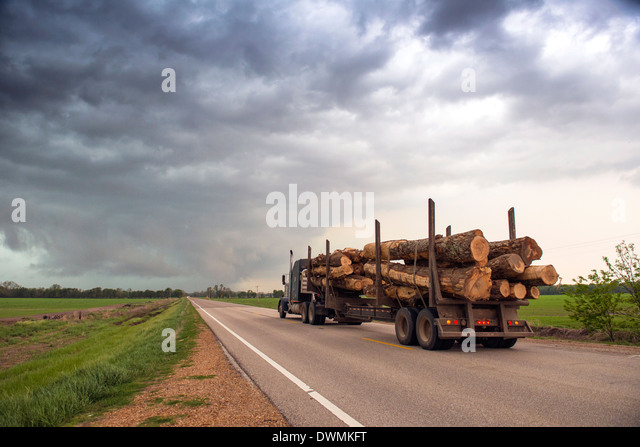Logging truck in Mississippi driving into the heart of a thunderstorm with an extreme tornado watch, United States - Stock Image