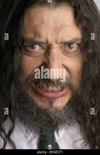 Man with long hair and beard wearing  tie. - Stock Image