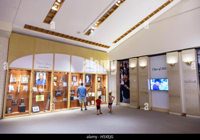 St. Saint Augustine Florida World Golf Village Hall of Fame inside museum exhibits golfing history man father boy - Stock Image