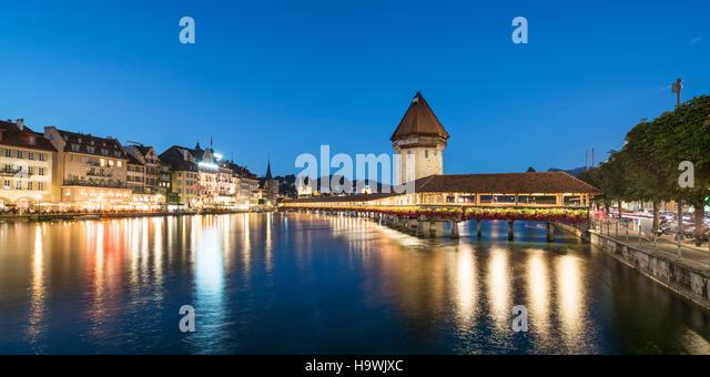 world heritage Chapel Bridge  at dusk, river Reuss, Lucerne, Switzerland - Stock Image