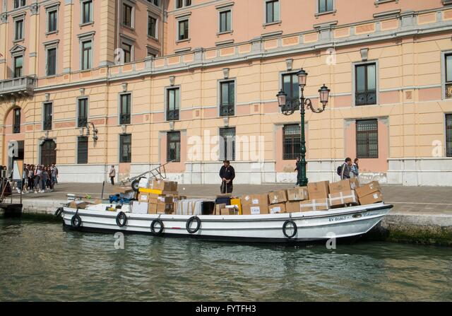 Delivery barge with parcels and supplies - Stock-Bilder