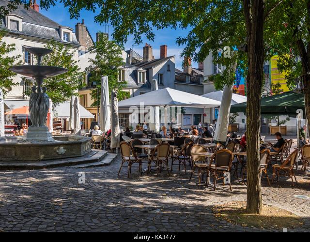 Cafe street life in Chinon, France. - Stock Image