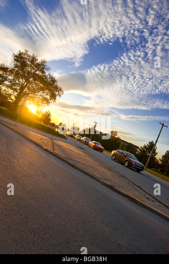 Cars & Traffic On Suburban Road With Beautiful Sunset During Evening Rush Hour Traffic, Philadelphia, USA - Stock Image
