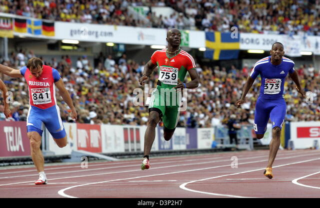 Portuguese Francis Obikwelu (C) wins ahead of French Ronald Pognon (R) and Russian Andrey Yepishin the men's - Stock Image