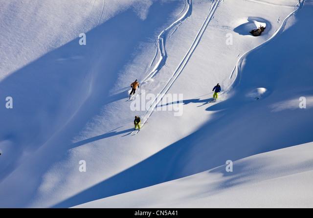 France, Savoie, Massif de La Vanoise, La Tarentaise Valley, Valmorel, teenager off-piste skiing in powder snow - Stock Image