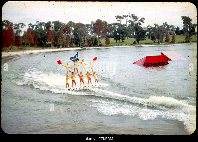 acrobatic skiers florida 1950s water lake women color slide - Stock Image