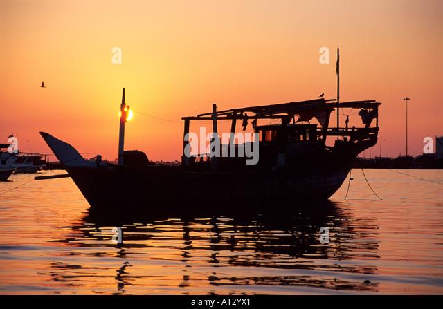 Dhow at sunset Abu Dhabi United Arab Emirates - Stock Image