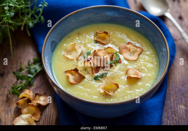 Parsnip soup with parsnip crisps - Stock Image