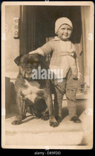 Boy And Bulldog - Stock Image