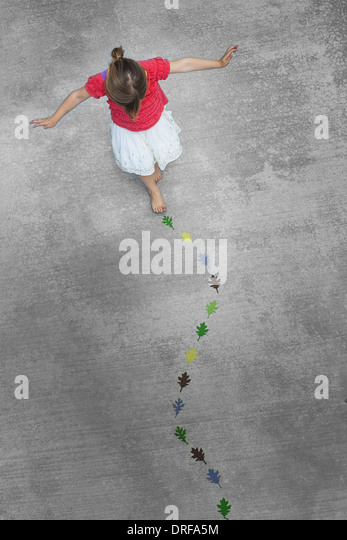 Utah USA child walking along line of coloured leaf shapes - Stock Image