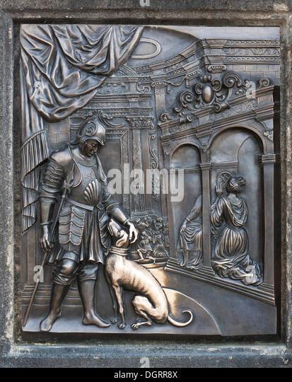 Bronze relief, Aristocrat with Dog, on the statue of St. John Nepomuk, Charles Bridge, Prague, Czech Republic, Europe - Stock Image