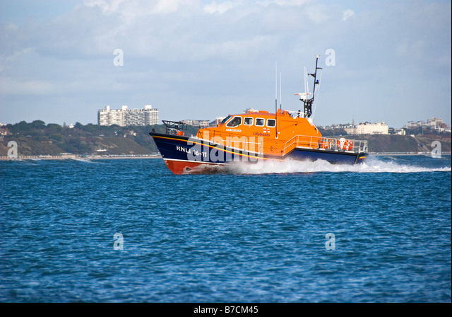RNLI LIfeboat returning to Poole Harbour - Stock Image