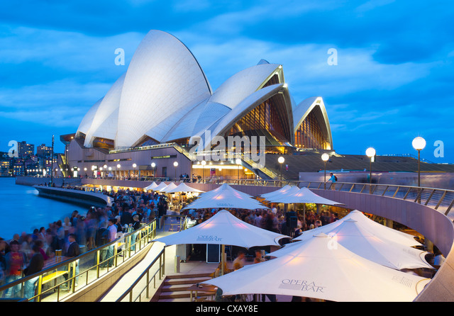 People at the Opera Bar in front of Sydney Opera House, UNESCO World Heritage Site, at night, Sydney, New South - Stock Image