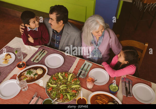 High angle view of grandparents and grandchildren in restaurant - Stock Image