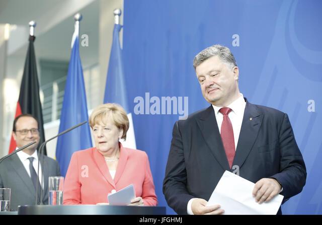 Merkel meets Hollande and Poroschenko in Berlin. - Stock Image