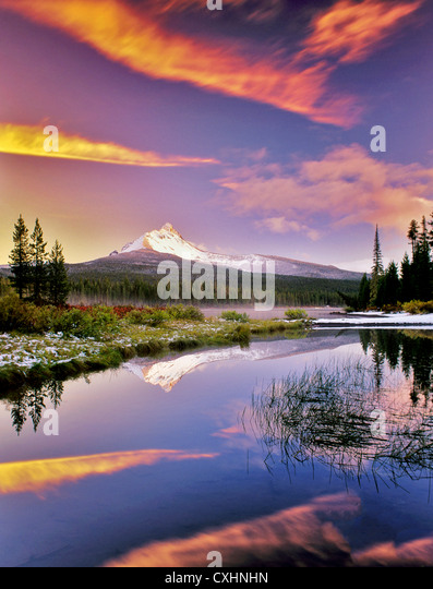 Mount Washington reflection in Big Lake with snow and sunset. Oregon. - Stock Image