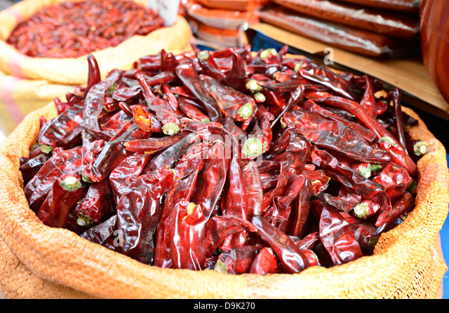 Dried peppers for sale at a market - Stock Image