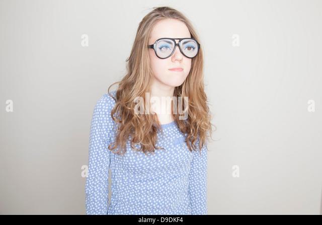 Girl wearing fake glasses - Stock Image