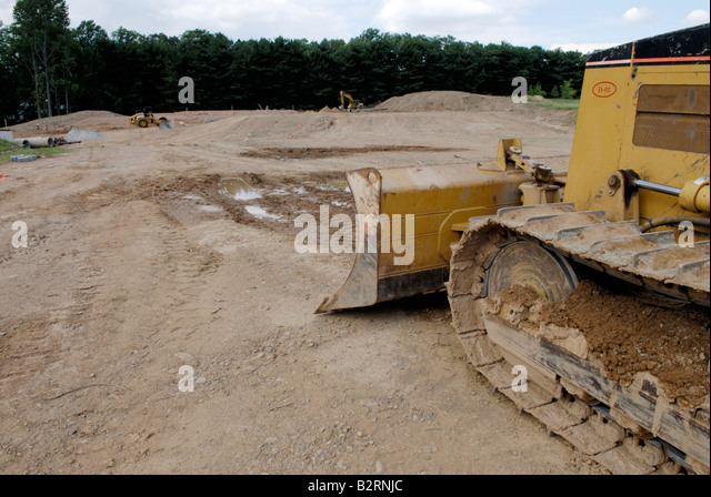 Bulldozer at clearing for a new housing development - Stock Image