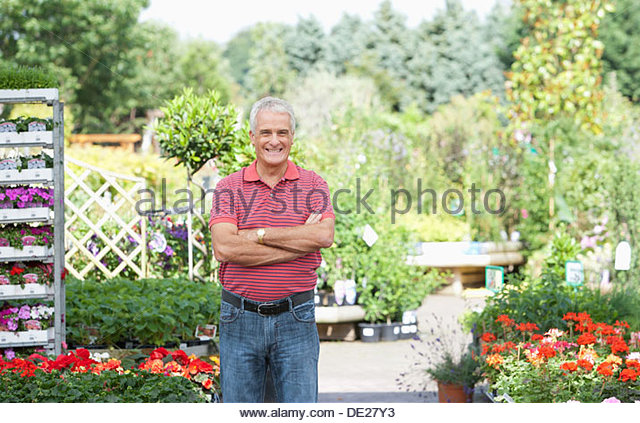 Mature man standing in garden - Stock Image