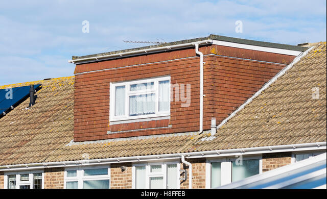 External view of a loft extension in the roof of a house in the UK. - Stock Image
