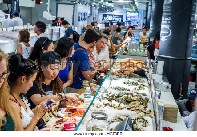 Manhattan New York City NYC NY Chelsea Chelsea Market The Lobster Place Seafood Market raw bar dining counter Asian - Stock Image