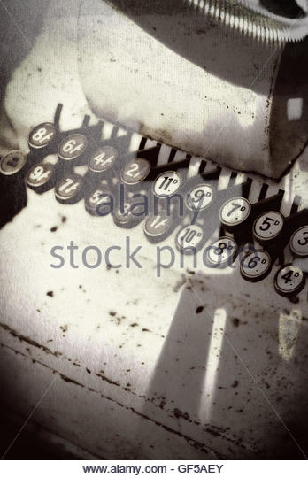 Vintage shop till keys moody image with strong shadows - Stock Image