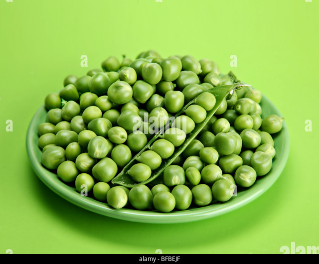 Green peas vegetable with seed closeup view - Stock Image