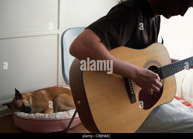 Teenager Playing Guitar - Stock Image