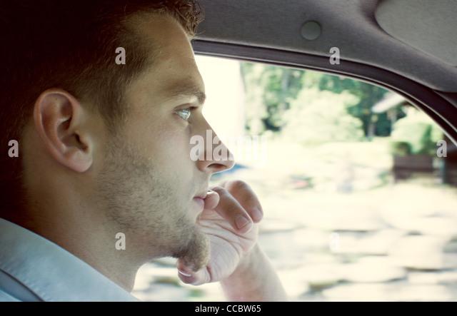Man driving car, portrait - Stock Image