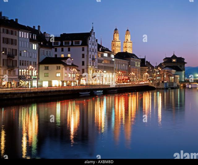 Switzerland Zurich Grossmunster Limmatquai twilight - Stock Image