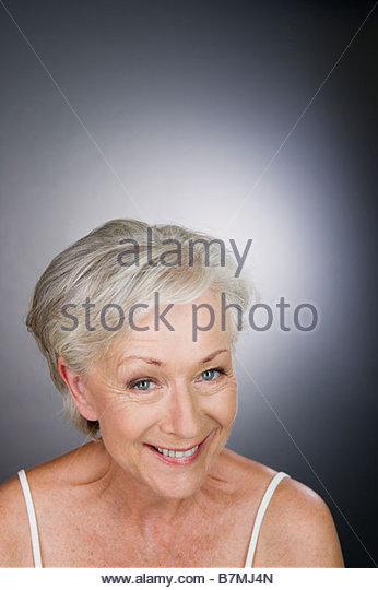 A senior woman smiling - Stock Image