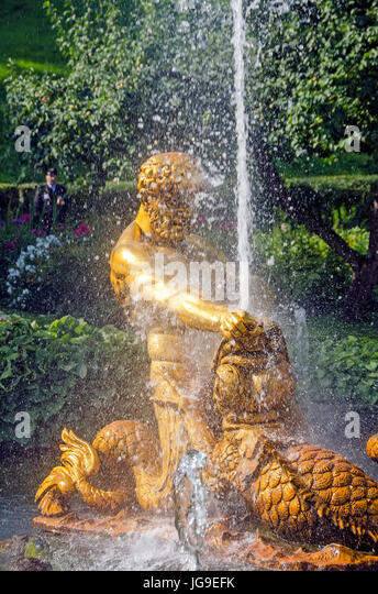 Peterhof Palace Triton Fountain in Orangie Garden depicts a triton grappling the jaws of a sea monster near St Petersburg - Stock Image