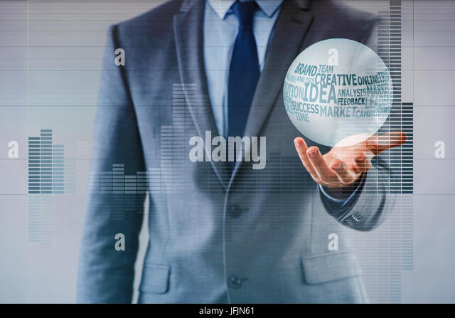 Businessman with crystal ball in business concept - Stock Image