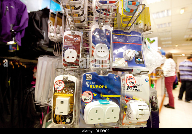 International travel plugs for sale in a shop, Norwich, UK - Stock-Bilder
