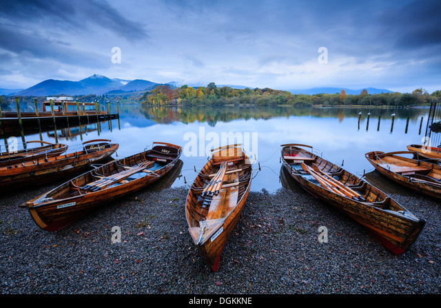 Rowing boats on the shore of Derwent Water near Keswick. - Stock Image